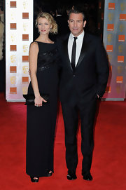 Jean Dujardin debuted a sharp look on the Orange British Academy Film Awards in an amazing suit with  shiny black lapel by Dior Homme.
