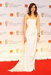 Kristen Wiig wore a strapless white ivory gown to the BAFTAs.