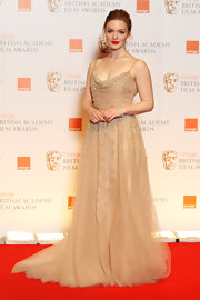 Holliday Grainger stepped out at the British Film Academy wearing a glamorous skin tone gown with gorgeous bead work.