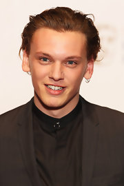 Jamie Campbell Bower sported a slicked-back look at the Orange British Academy Film Awards.
