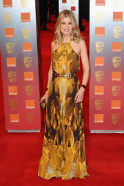 Rosamund was breathtaking in a burnt yellow abstract print evening dress in a halter design at the BAFTA Awards.