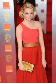 Actress and nominee Emma Stone attended the 2011 Orange British Academy Film Awards wearing rose gold Magic hoop earrings.
