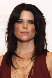 Neve Campbell looked sultry in smoky eye makeup.