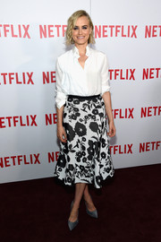 Taylor Schilling styled her simple top with a charming black-and-white floral skirt, also by Vionnet.