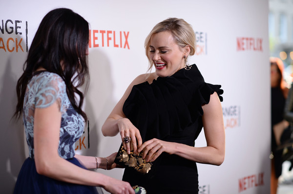 More Pics of Taylor Schilling Velvet Clutch (1 of 22) - Taylor Schilling Lookbook - StyleBistro [orange is the new black,yellow,beauty,hairstyle,dress,fashion,little black dress,premiere,design,event,carpet,laura prepon,taylor schilling,new york city,sva theater,premiere]