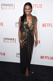 Vicky Jeudy looked divine in a gold wrap dress with a plunging neckline at the New York premiere of 'Orange is the New Black.'