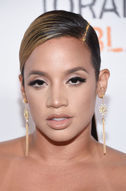 Dascha Polanco rocked a slicked-down ponytail with glittered roots at the New York premiere of 'Orange is the New Black.'