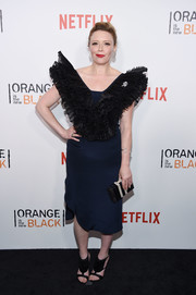 Natasha Lyonne topped off her ensemble with a monochrome box clutch.