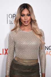 Laverne Cox shimmered in a metallic outfit styled with a vintage Chanel gold chain belt at the New York premiere of 'Orange is the New Black.'