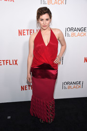 A red maxi skirt with a cutout hem finished off Yael Stone's outfit.