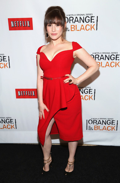 Yael wore this fitted red frock that featured a wrapped skirt and cinched waist.