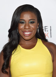 Uzo Aduba was bold with colors, pairing blue eyeshadow with a lemon-yellow dress.