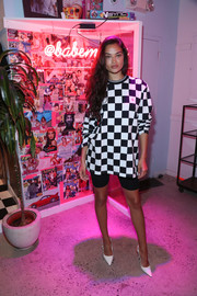 Shanina Shaik teamed her tee with a pair of black bike shorts.