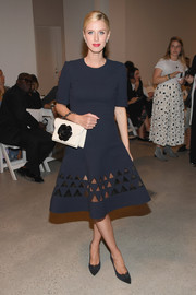 Nicky Hilton attended the Oscar de la Renta fashion show looking classy in a navy fit-and-flare dress with triangular cutouts along the hemline.