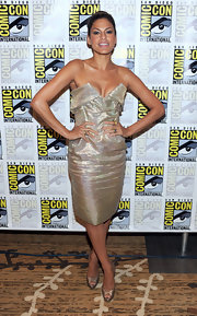 The actress went glam in a strapless metallic dress with bronze peep toe pumps.