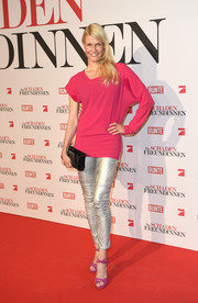 Natascha Gruen added major shine via a pair of silver leather skinnies.