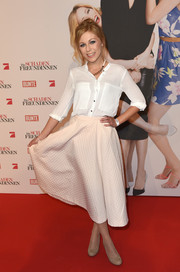 Anna Ewelina attended the German premiere of 'The Other Woman' wearing a casual yet stylish white button-down shirt.