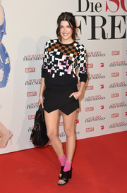 Marie Nasemann showed off her fab legs in a structured black mini skirt.