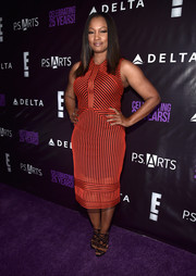 Garcelle Beauvais' geometric cage sandals worked beautifully with her striped dress.