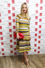 Laura Whitmore was stunning in stripes wearing a Jasper Conran knee-length frock to the Pandora & BHF afternoon tea party in London, England.
