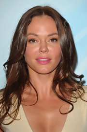 Rose McGowan wore her hair in tousled curls that were parted down the center at the Crystal + Lucy Awards.