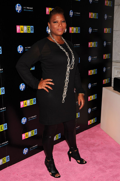 Queen Latifah brings life to an all-black outfit with her accessories, including her leather cut-out sandals.