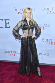 Katherine McNamara looked sassy in a sheer black and gold shirtdress layered over cigarette pants at the world premiere of 'A Quiet Place Part II.'