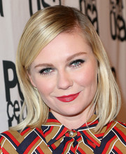 Kirsten Dunst styled her hair in a side-parted wispy hairstyle.