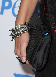 Jenna paired her cocktail dress with sparkling silver bangles.