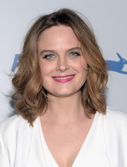 Emily Deschanel wore her tresses down to her shoulders with bouncy waves when she attended PETA's 35th anniversary party.