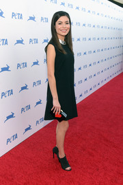 Miranda Cosgrove complemented her LBD with black open-toe booties.