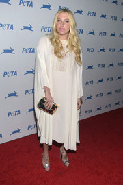 Kesha hid her figure under a loose white tunic dress with embroidered bib detailing during PETA's 35th anniversary party.