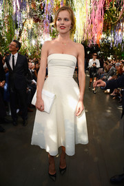 Eva Herzigova looked ageless at the Christian Dior fashion show in a white strapless dress that accentuated her tiny waist.