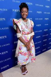 Amanda Gorman teamed a beige shawl with her matchy-matchy crop-top and skirt combo at the 2018 Porter Incredible Women Gala.