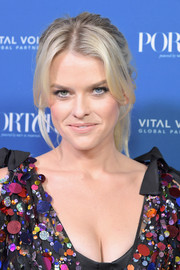 Alice Eve attended the 2018 Incredible Women Gala wearing a messy-chic ponytail.