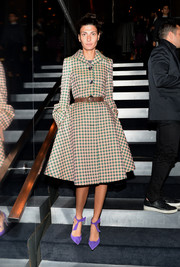 Giovanna Battaglia sported a shapely silhouette in a pink and green gingham coat during the Prada Journal event.