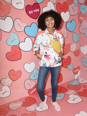 Yara Shahidi paired her jacket with blue skinny jeans.