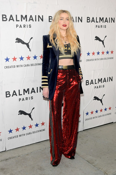 Amber Heard was military-chic in a navy velvet blazer with gold braid detailing at the Puma x Balmain launch in LA.