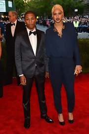Pharrell Williams chose this gray and black checked suit for his cool and dapper red carpet look at the Met Gala.