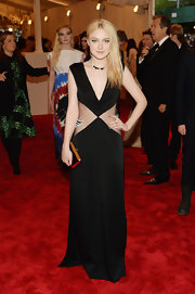 Dakota Fanning kept her look classic and sleek with this black geometric gown that featured a plunging V-neck and sheer mesh panels on the waist.