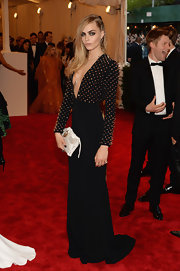 Cara Delevingne chose a navy studded column dress with a deep V-neck for her look at the 2013 Met Gala.