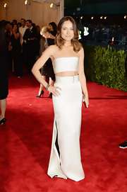 Olivia Wilde chose a satin bandeau top and long skirt for her chic ab-bearing look at the 2013 Met Gala.