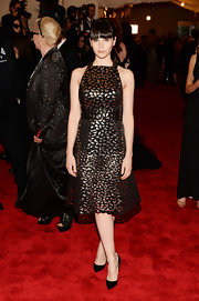Felicity Jones chose this black and copper lace dress for her punky look at the Met Gala.