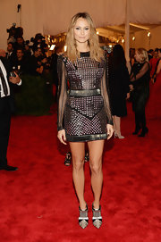 Stacy brought out the punk style with this studded mini dress that featured sheer sleeves and a cinched in waist.