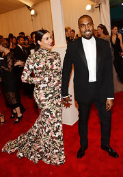 Kanye West chose this crisp black suit and a white button down, without a tie, for his look at the Met Gala.