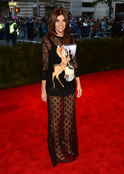 Carine Roitfeld chose this funky evening dress that featured a polka dot sheer skirt and a Bambi-print top.