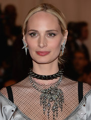 Lauren Santo Domingo balanced out her tough-looking choker with an ultra-glam diamond chandelier necklace.