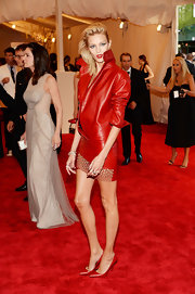 Anja Rubik looked strikingly stylish at the Met Gala in her red leather dress and pointy pumps combo.