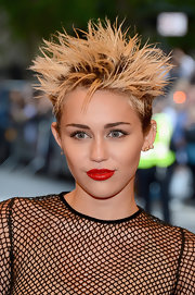 Miley went bold all the way with this classic red lip color.