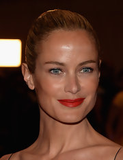 Carolyn Murphy topped off her classic red carpet look with a vibrant red lip that has a subtle orange undertone.